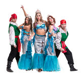 Carnival dancer team dressed as mermaids and pirates.  Isolated on white background in full length. Royalty Free Stock Photo