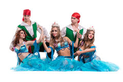 Carnival dancer team dressed as mermaids and pirates.  Isolated on white background in full length. Royalty Free Stock Photography