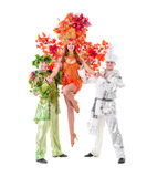 Carnival dancers dancing against isolated white Royalty Free Stock Photos