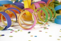Carnival deco. Colorful carnival deco with confetti and streamers Royalty Free Stock Photo