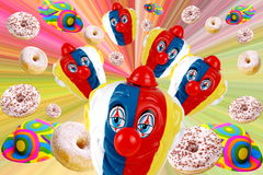 Carnival. Decorations on white background full of colors and donuts Stock Image