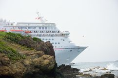 Carnival Ecstasy  Cruise ship leaving port with rocks in Foreground Stock Images