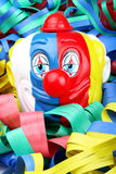 Carnival. Face of clown in the foreground with confetti Royalty Free Stock Photos