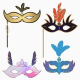 Carnival face masks with feathers and handle. Set of decoration for masquerade party. Vector. Carnival face masks with feathers and handle. Set of decoration vector illustration