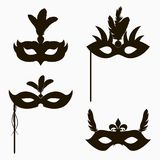 Carnival face masks icons. Set of isolated silhouette decoration for masquerade party with feathers and handle. Vector. Carnival face masks icons. Set of royalty free illustration