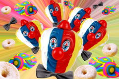 Carnival. Faces of clown with carnival decorations on background full of colors Stock Image