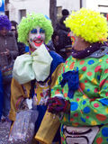 Carnival faces - the clowns. Carnival portrait of young girls  at traditional italian carnival in Morbegno (Sondrio) - Italy - the parade of floats and masked Stock Photo