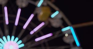 Carnival fair grounds at night. Defocused footage. Shot in 4K RAW on a cinema camera stock footage