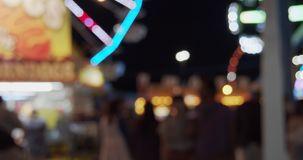 Carnival fair grounds at night. Defocused footage. Shot in 4K RAW on a cinema camera stock video