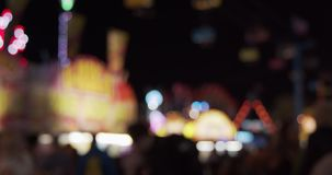 Carnival fair grounds at night. Defocused footage. Shot in 4K RAW on a cinema camera stock video footage
