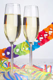 Carnival - Fasching. 2 Glasses of Sparkling Wine with carnival decoration - 2 Sektfloeten vor Papiergirlande Royalty Free Stock Photo