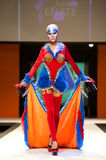 Carnival Fashion Week. CANARY ISLANDS - 29 OCTOBER: Model on the catwalk wearing carnival costume from designer Juan Penate during Carnival Fashion Week October Royalty Free Stock Images