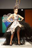 Carnival Fashion Week. CANARY ISLANDS - 29 OCTOBER: Model on the catwalk wearing carnival costume from designer Julio Vicente Artiles during Carnival Fashion Royalty Free Stock Image