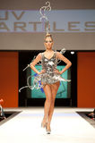 Carnival Fashion Week. CANARY ISLANDS - 29 OCTOBER: Model on the catwalk wearing carnival costume from designer Julio Vicente Artiles during Carnival Fashion Royalty Free Stock Photo