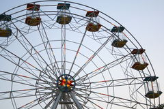 Carnival ferris wheel. By sunset royalty free stock photos