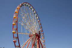 Carnival Ferris Wheel with Clean Skies with Empty Space Close up shot of half of a ferris wheel Royalty Free Stock Images