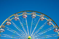 Carnival Ferris Wheel with Clear Skies Stock Images