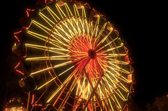 Carnival Ferris Wheel Lit Up At Night. Retro colors of carnival ferris wheel at night Royalty Free Stock Image