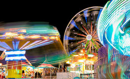 Carnival and Ferris Wheel at Night Spinning Lights Royalty Free Stock Photo