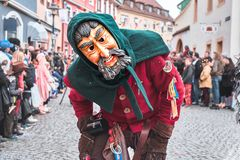 Carnival figure with man Mask with beard. Street carnival in southern Germany - Black Forest stock image
