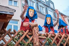 Carnival figures on a cart with wooden fence. royalty free stock image