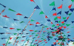 Carnival flags. Colourful carnival flags with the blue sky in summer day Royalty Free Stock Photo