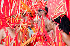 Carnival flames. Masqueraders in beautiful flame costumes and headdress take part in Carnival Tuesday celebrations in Port Of Spain Trinidad Royalty Free Stock Image