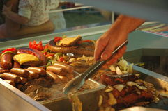 Carnival food. Close-up of carnival food including hot dogs, hamburgers, sausages Stock Image