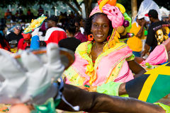 Carnival fruit and vegetables. Female band member in a beautiful costume with plastic fruits and vegetables, at the Junior Parade of the Bands festivities during Stock Photography