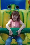 Carnival Fun. Little girl sitting on a carnival ride Stock Photography