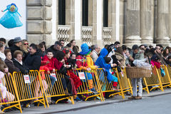 Carnival in Galicia (Spain). PONTEVEDRA, SPAIN - FEBRUARY 21, 2015: A candy seller offered their product spectators who wait the parade of costumed stroll the Royalty Free Stock Photography