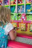 Carnival Game. Cute little girl playing a carnival game royalty free stock images