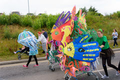 Carnival of the giants festival parade in Telford Shropshire. Children and adults taking part in the under the sea carnival at Telford Royalty Free Stock Images