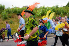 Carnival of the giants festival parade in Telford Shropshire. Children and adults taking part in the under the sea carnival at Telford Stock Photography