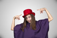 Carnival girl with funny face and red hat Royalty Free Stock Photography