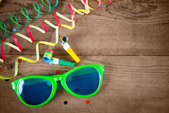Carnival glasses and whistle on wood Stock Photography