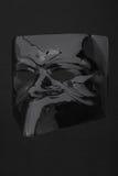 Carnival glossy black mask on black Stock Photos