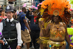 Carnival goer & policeman at Notting Hill Carnival Royalty Free Stock Photo