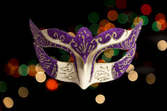 Carnival Halloween mask on bokeh background. Stock Image