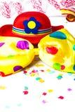 Carnival hat, bow tie, confetti Stock Image