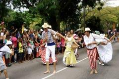 Carnival ispiration, photographer & folk dancers.  Royalty Free Stock Photography
