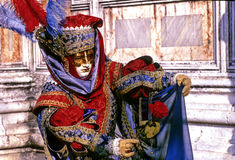 Carnival- Italy. Elaborately dressed Carnivale figure in Piazza San Marco- Venice, Italy Stock Photography