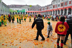 Carnival of Ivrea. The battle of oranges. IVREA - MARCH 3: Carnival of Ivrea. The battle of oranges. By the end of the day, the squares of Ivrea with the juice royalty free stock photos