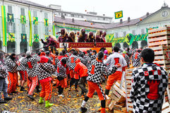 Carnival of Ivrea. The battle of oranges. IVREA - MARCH 3: Carnival of Ivrea. The battle of oranges. The throwing in the square of the Chess. On March 3, 2014 royalty free stock photo