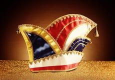 Carnival Jester Hat on Glittery Platform Stock Photos