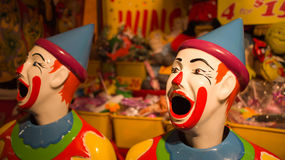 Carnival laughing clowns. Laughing clowns game in a carnival. This is a typical game in a fair, fete or carnival where you feed the balls into the clown's Stock Images