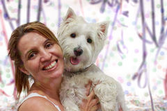Carnival mama and dog. Carnival Party time with a West Highlander White Terrier and its mama Stock Images