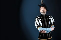 Carnival man. Portrait of a handsome man grandee in 16th century costume. Shot in a studio Stock Photos