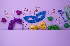 Carnival or mardi gras background with carnival masks, beards and photo booth props royalty free stock photography