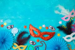 Carnival or mardi gras background with carnival masks, beards and photo booth props stock photo